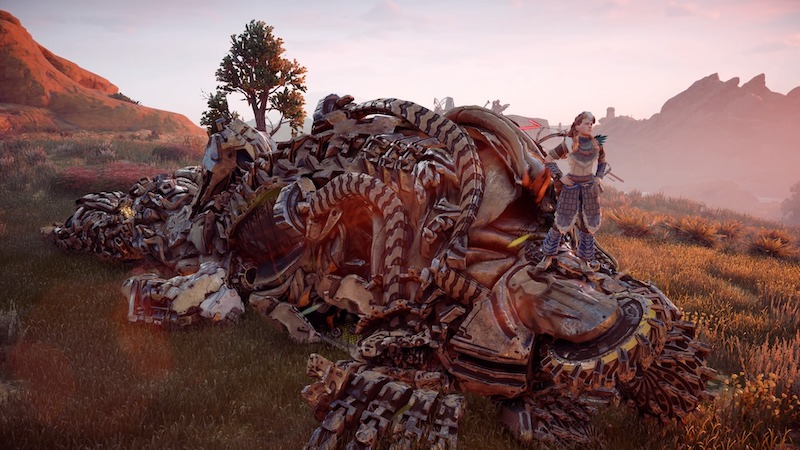 Aloy standing on a dead machine