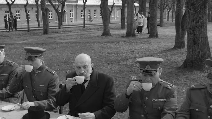 Military sitting down and having tea during Nova Lituania