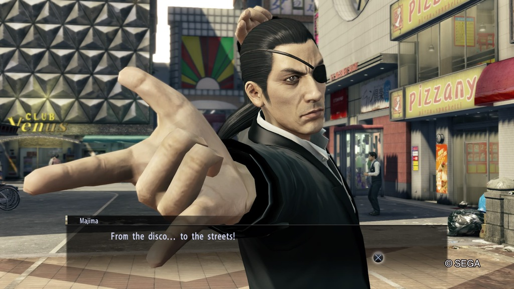 Majima striking a dance pose