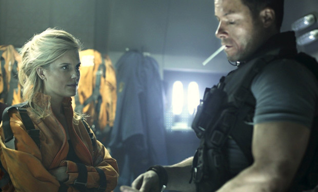 Guy Pearce and Maggie Grace in Lockout